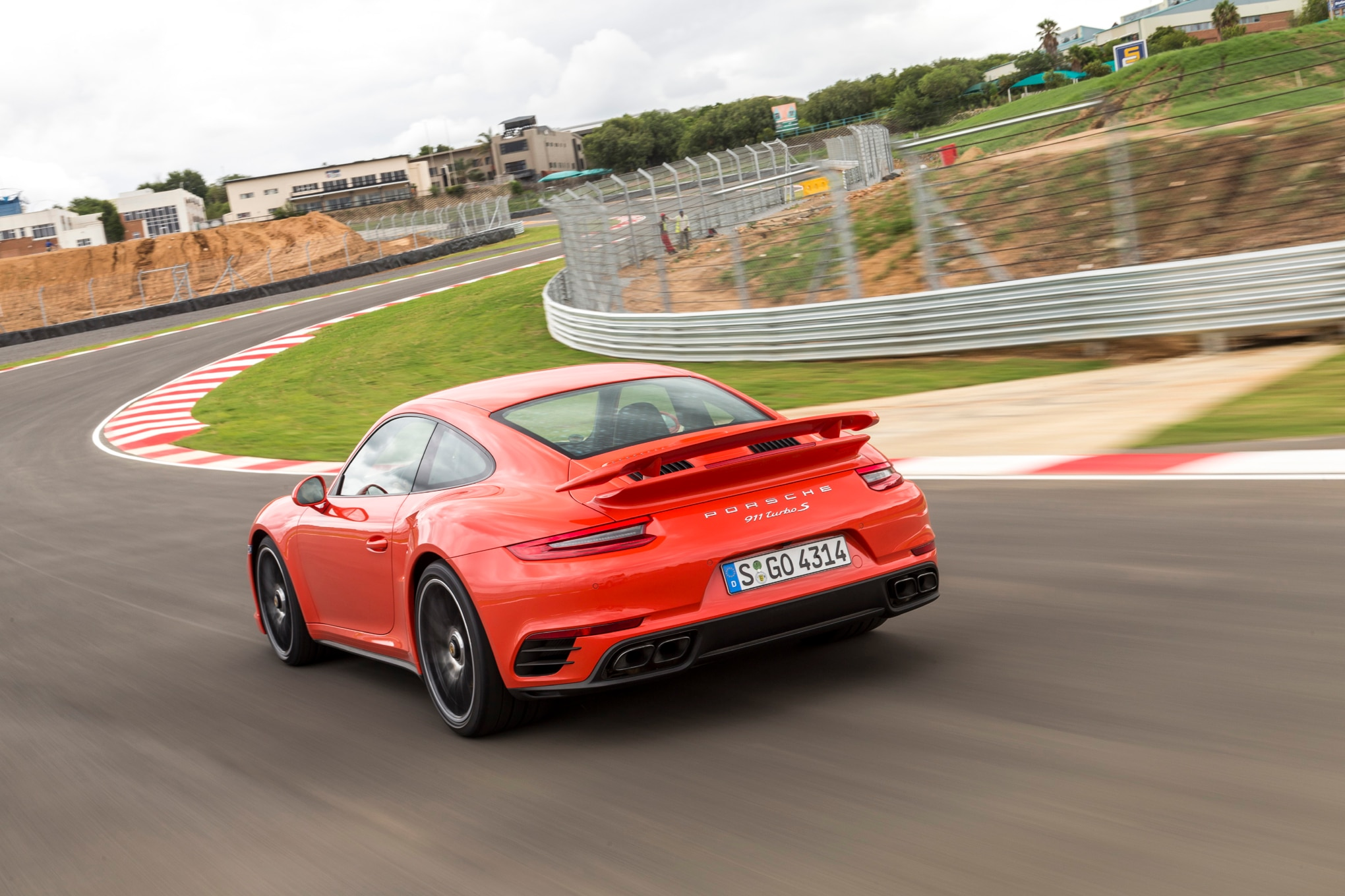 2017 Porsche 911 Turbo S rear three quarter in motion