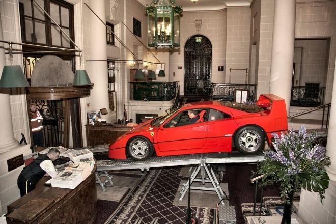 Ferrari F40 descends the loading ramp to street level, 9 feet below the display area.