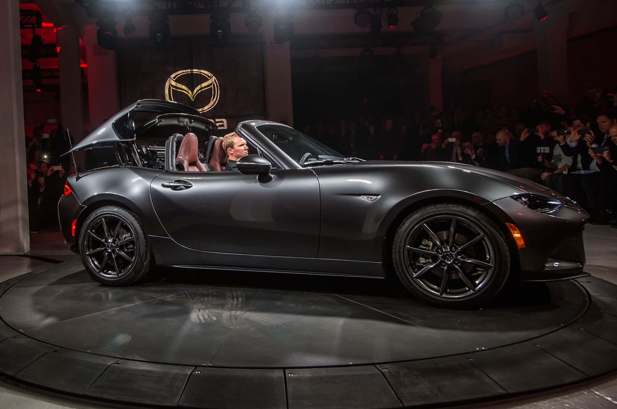 http://st.automobilemag.com/uploads/sites/11/2016/03/2017-Mazda-MX-5-Miata-RF-on-stage-side-view-top-folding.jpg