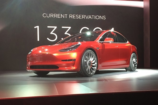 tesla model 3 live red front three quarter
