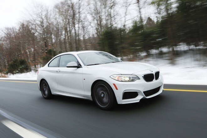 2014 BMW M235i front three quarter in motion 02
