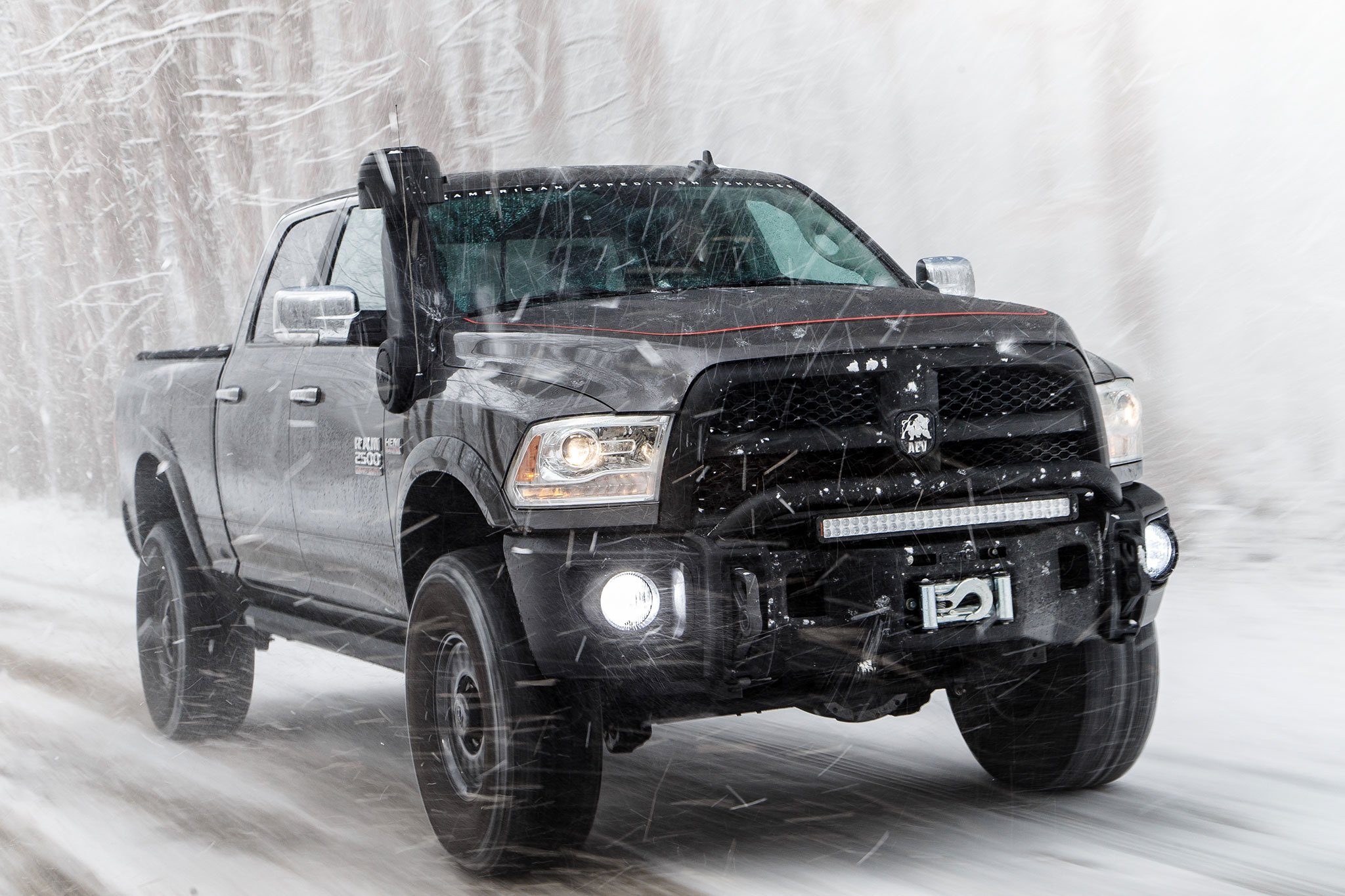 2015 AEV Prospector Ram 2500 Power Wagon front three quarter in motion ...