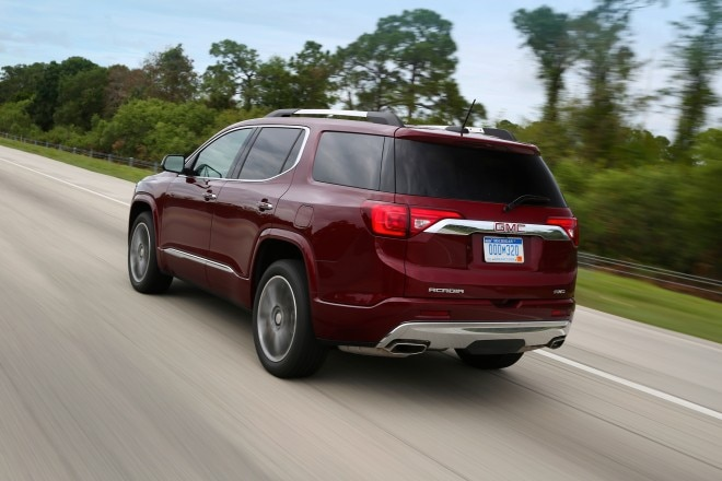 2017 GMC Acadia rear three quarter in motion 01