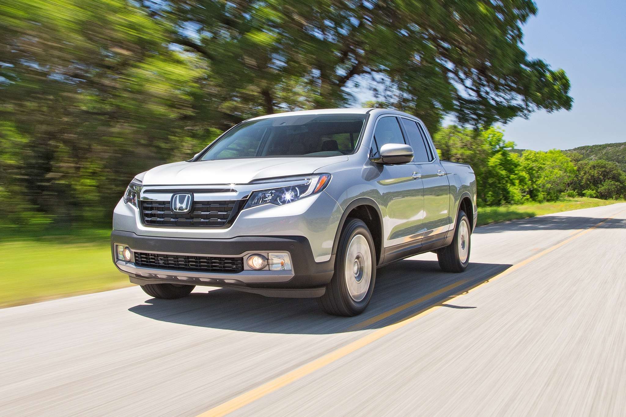 2017 Honda Ridgeline Front Three Quarter In Motion 02