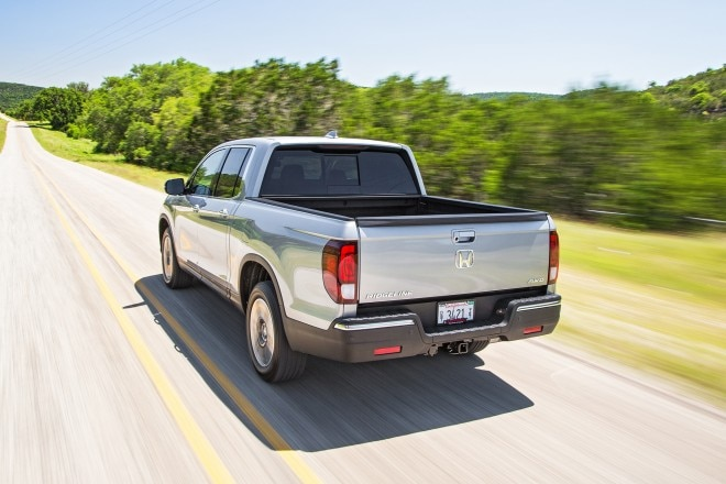 2017 Honda Ridgeline rear three quarter in motion 02
