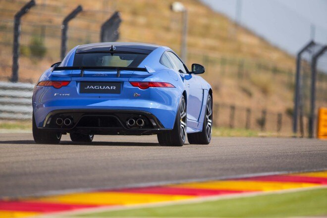 2017 Jaguar F Type SVR coupe rear three quarters in motion 09
