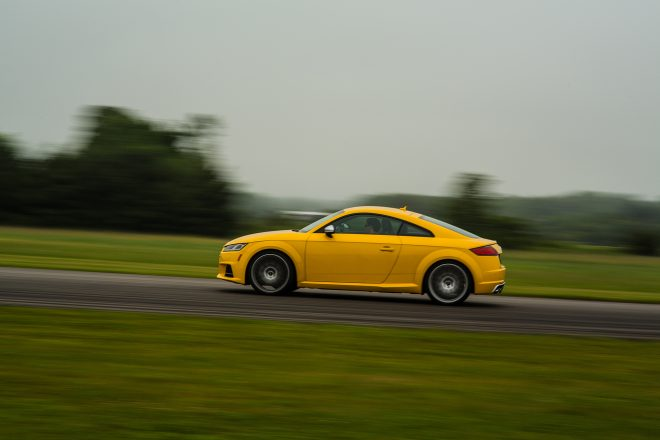 2016 Audi TTS coupe side profile in motion