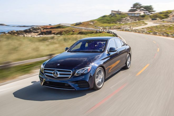 2017 Mercedes Benz E300 4Matic front three quarter in motion 08