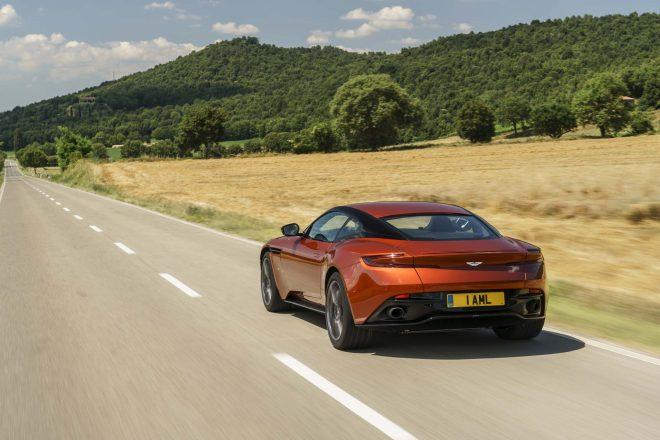 2017 Aston Martin DB11 rear three quarter in motion 3