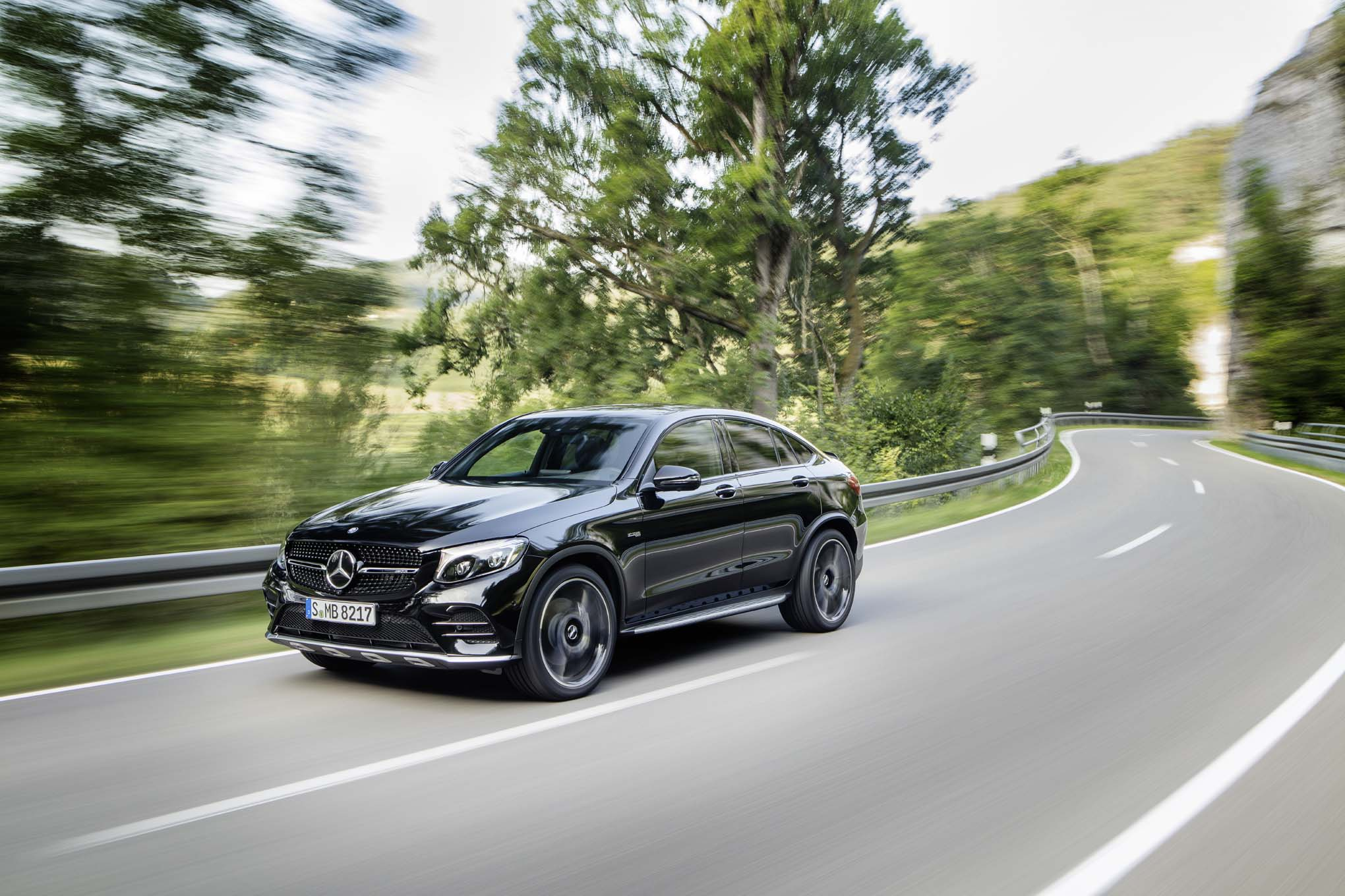 http://st.automobilemag.com/uploads/sites/11/2016/08/2017-Mercedes-AMG-GLC43-coupe-front-three-quarters-in-motion.jpg