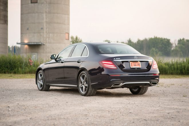 2017 Mercedes Benz E300 4MATIC rear three quarter 01
