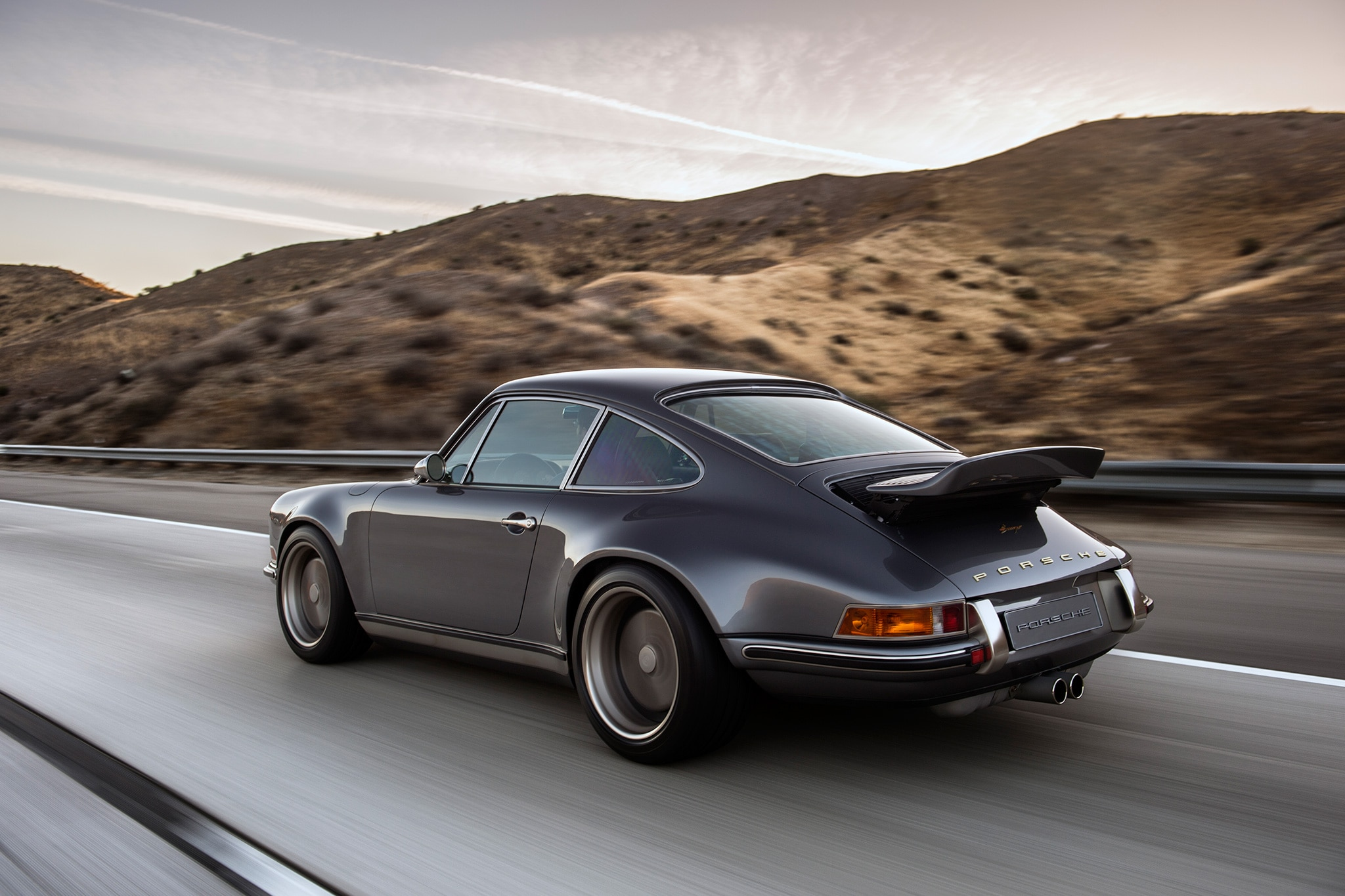 a lovely pair of porsche 911s by singer showed up at pebble automobile magazine. Black Bedroom Furniture Sets. Home Design Ideas