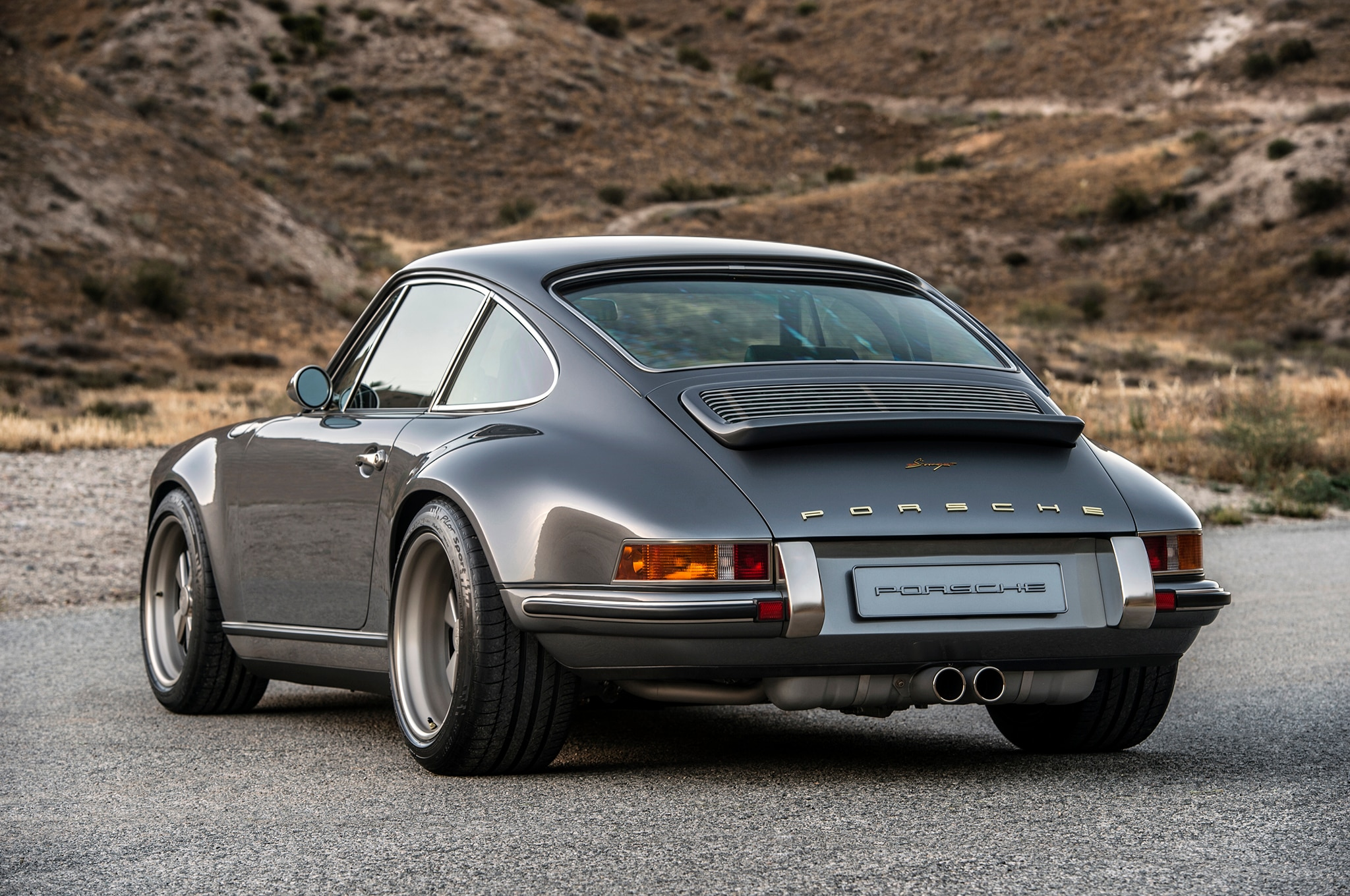 a lovely pair of porsche 911s by singer showed up at pebble