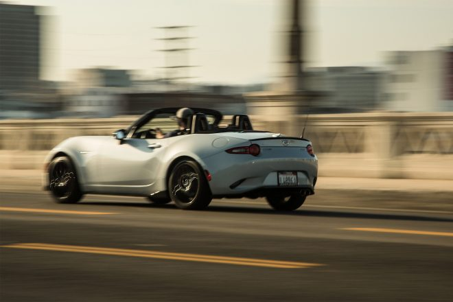 2016 Mazda MX 5 Miata Club rear three quarter in motion 01