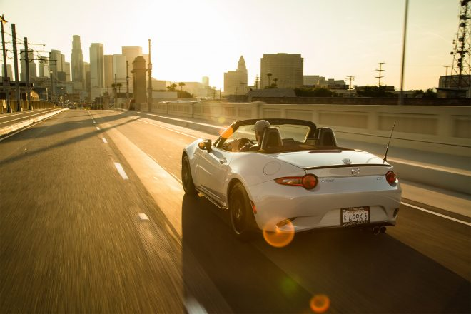 2016 Mazda MX 5 Miata Club rear three quarter in motion 05