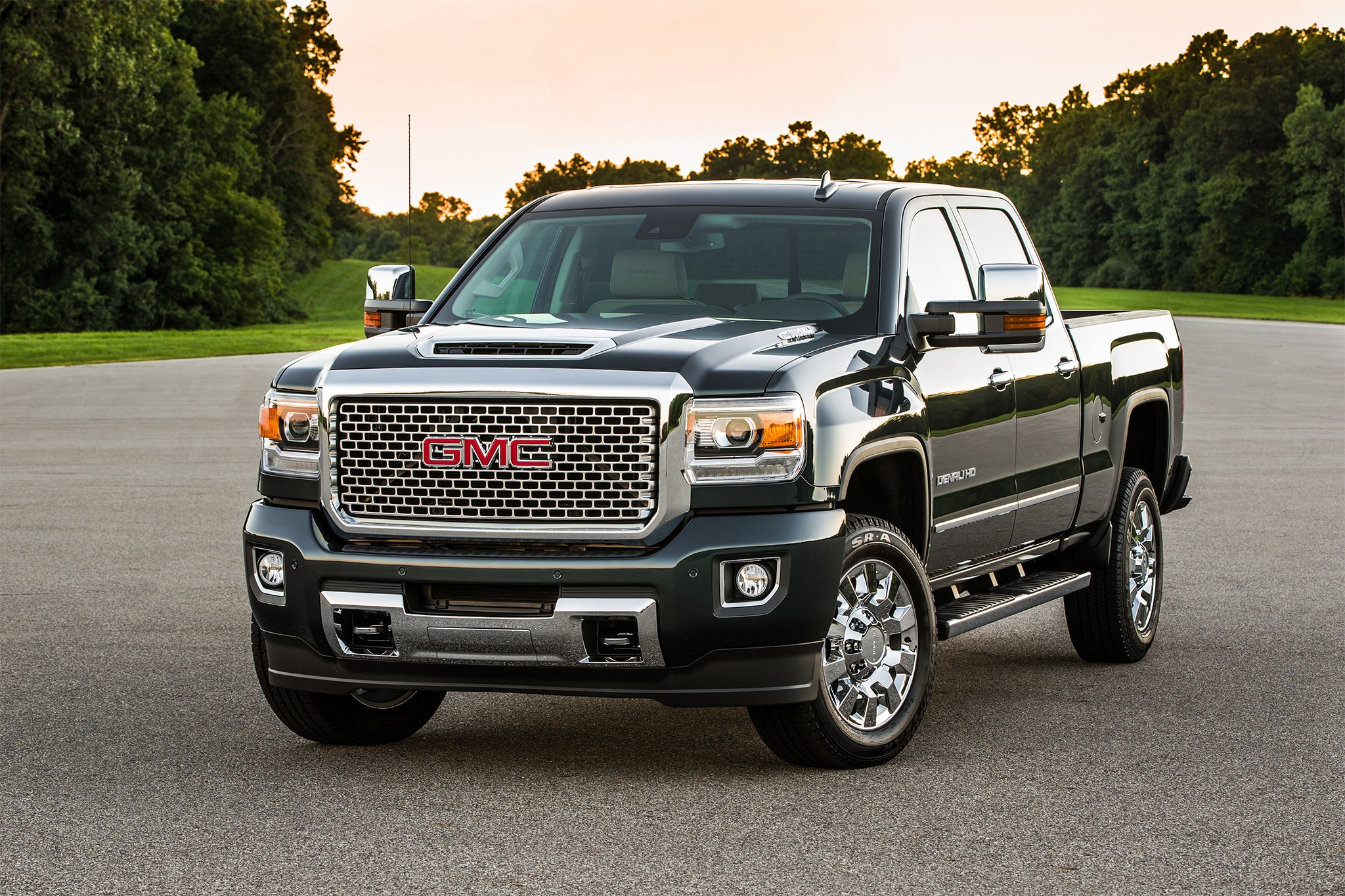 2017 GMC Sierra Denali 2500HD front three quarter 02 chevy and ram score a grand slam at the 2016 state fair of texas  at money-cpm.com