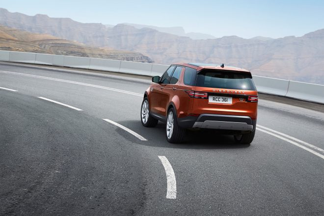 2017 Land Rover Discovery rear three quarter in motion 03
