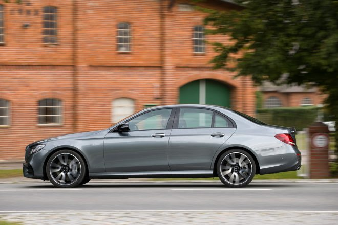 2017 Mercedes AMG E43 sedan side profile in motion 01