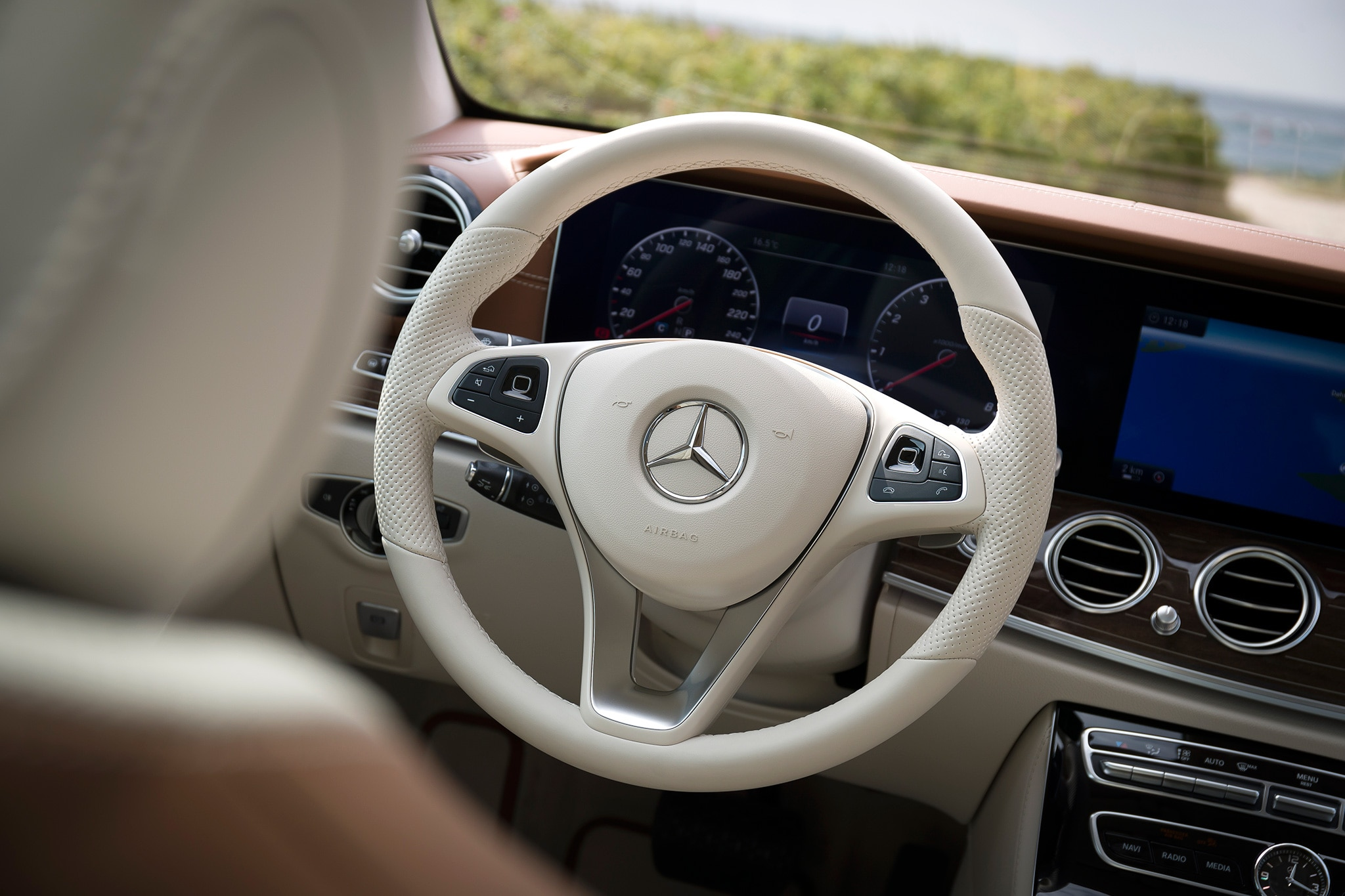 First drive 2017 mercedes benz e400 4matic wagon for Mercedes benz steering wheel