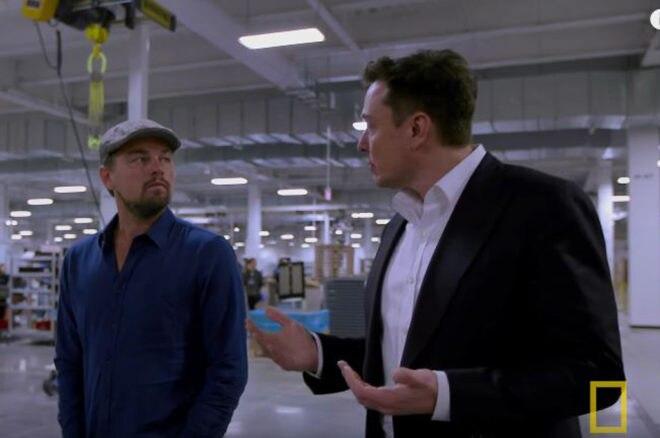 Elon Musk And Leonardo DiCaprio In Tesla Gigafactory Screen Shot 660x438