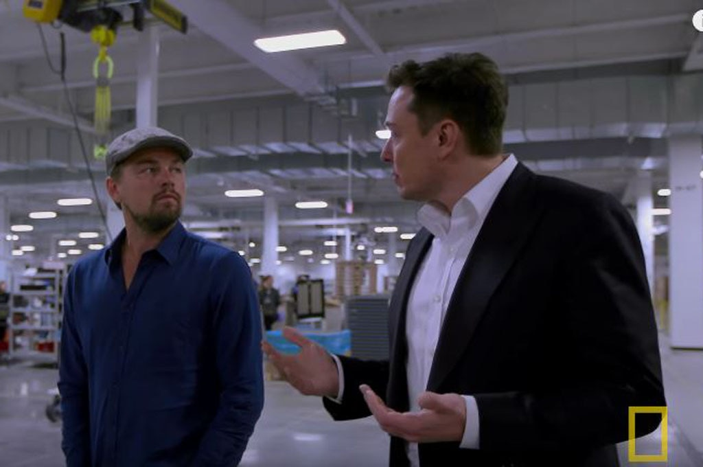 Elon Musk And Leonardo DiCaprio In Tesla Gigafactory Screen Shot