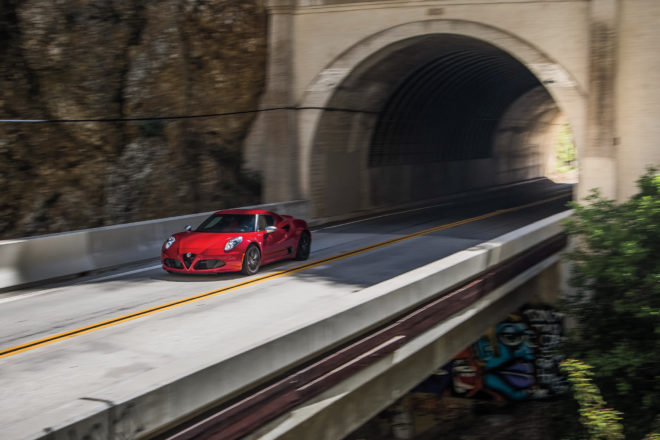 2015 Alfa Romeo 4C Coupe front three quarter in motion 01