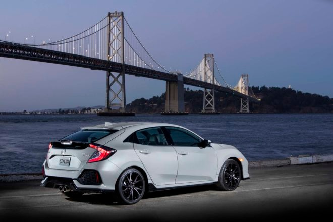 2017 Honda Civic Hatchback Sport Touring rear three quarter 03