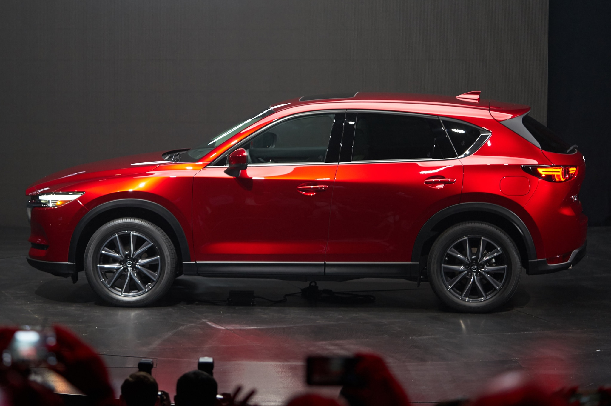 http://st.automobilemag.com/uploads/sites/11/2016/11/2017-Mazda-CX-5-side-view-on-stage.jpg