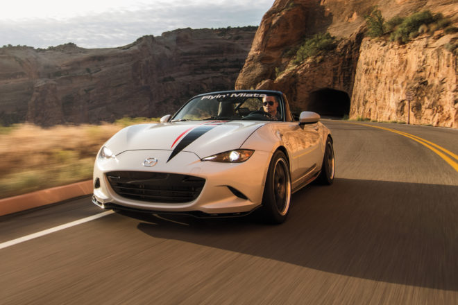 Flyin Miata LS3 V8 2016 Mazda MX 5 front three quarter in motion 01