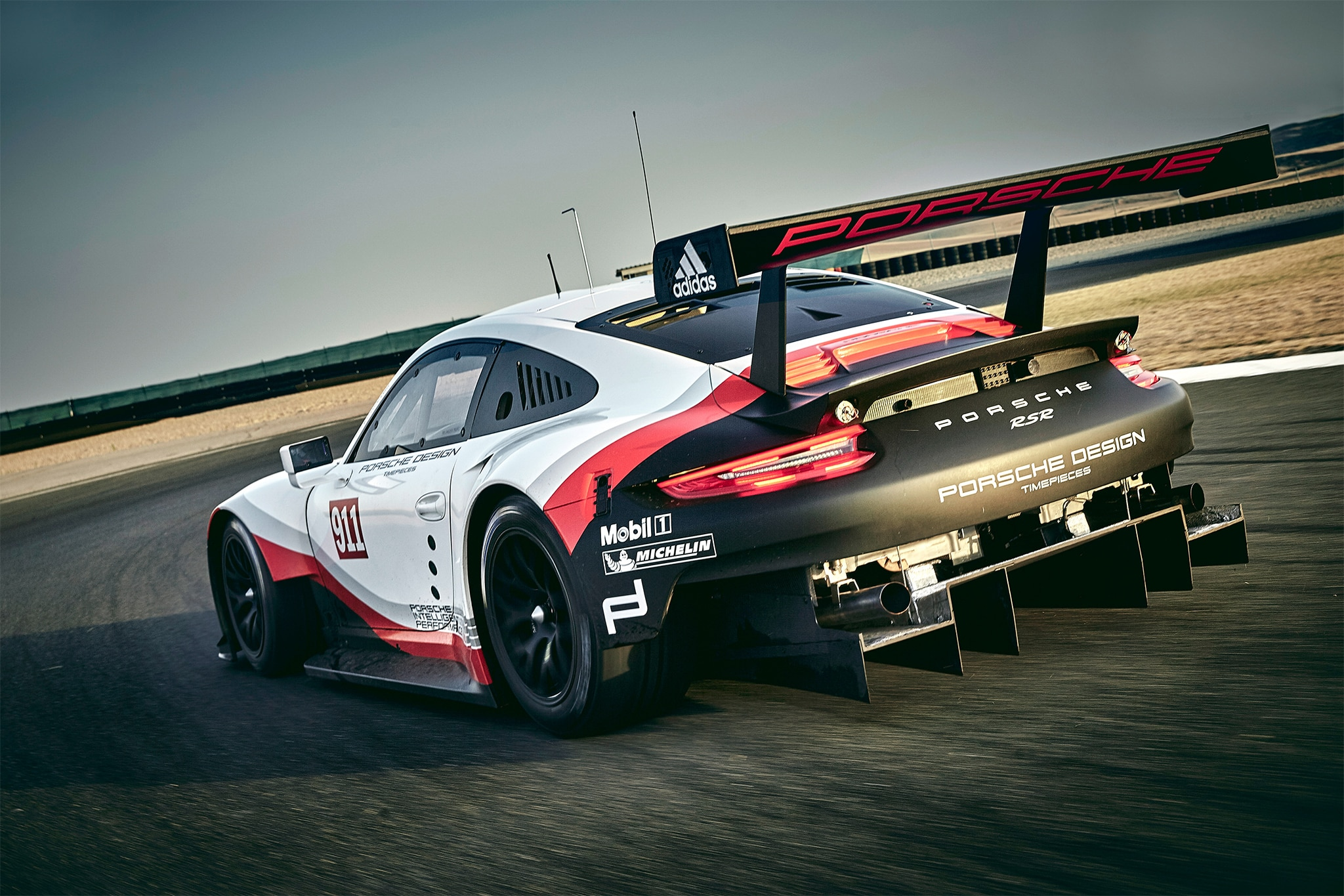 Porsche 911 RSR Rear Three Quarter In Motion 01
