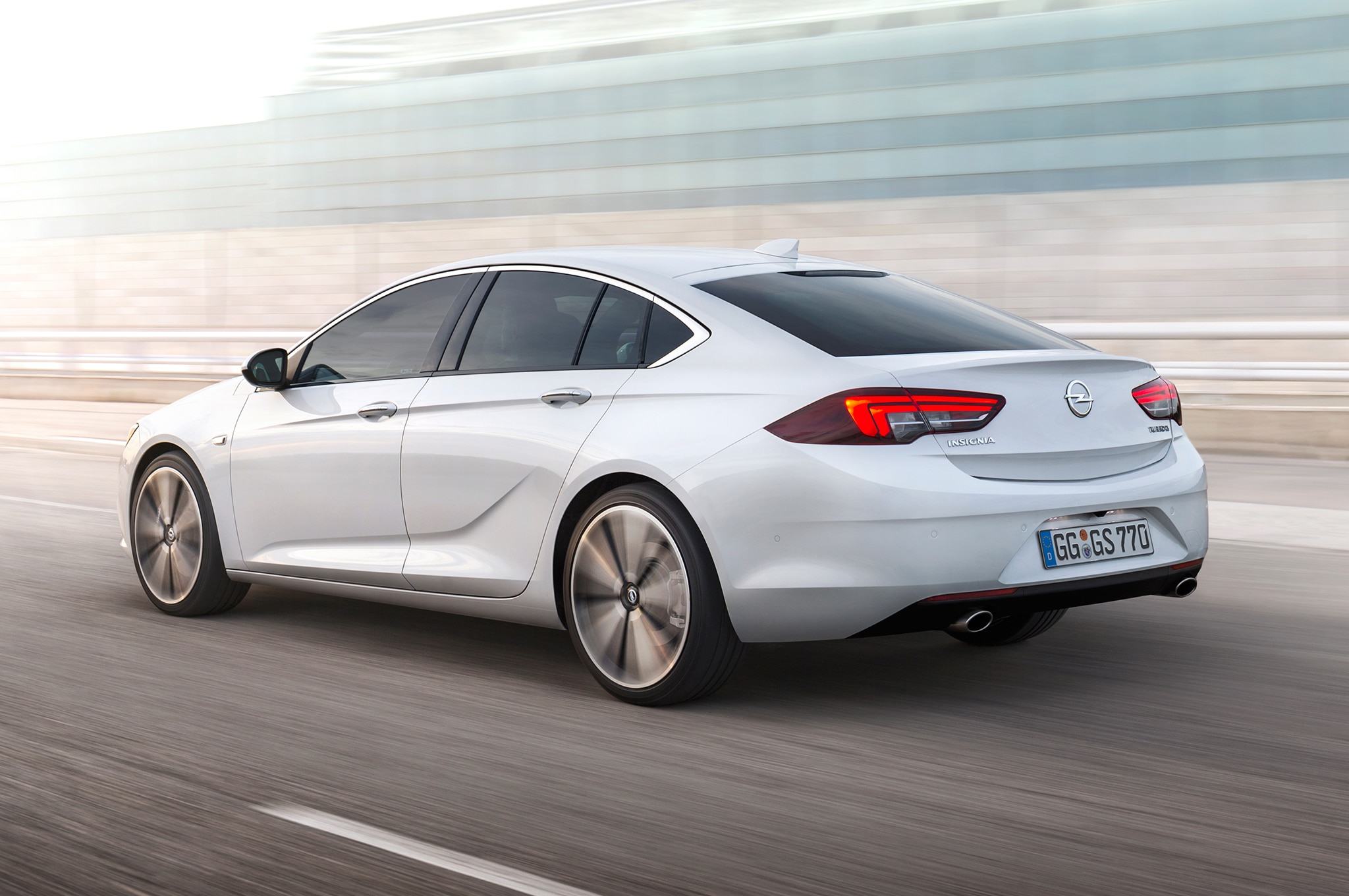 Opel Insignia Grand Sport rear three quarter in motion