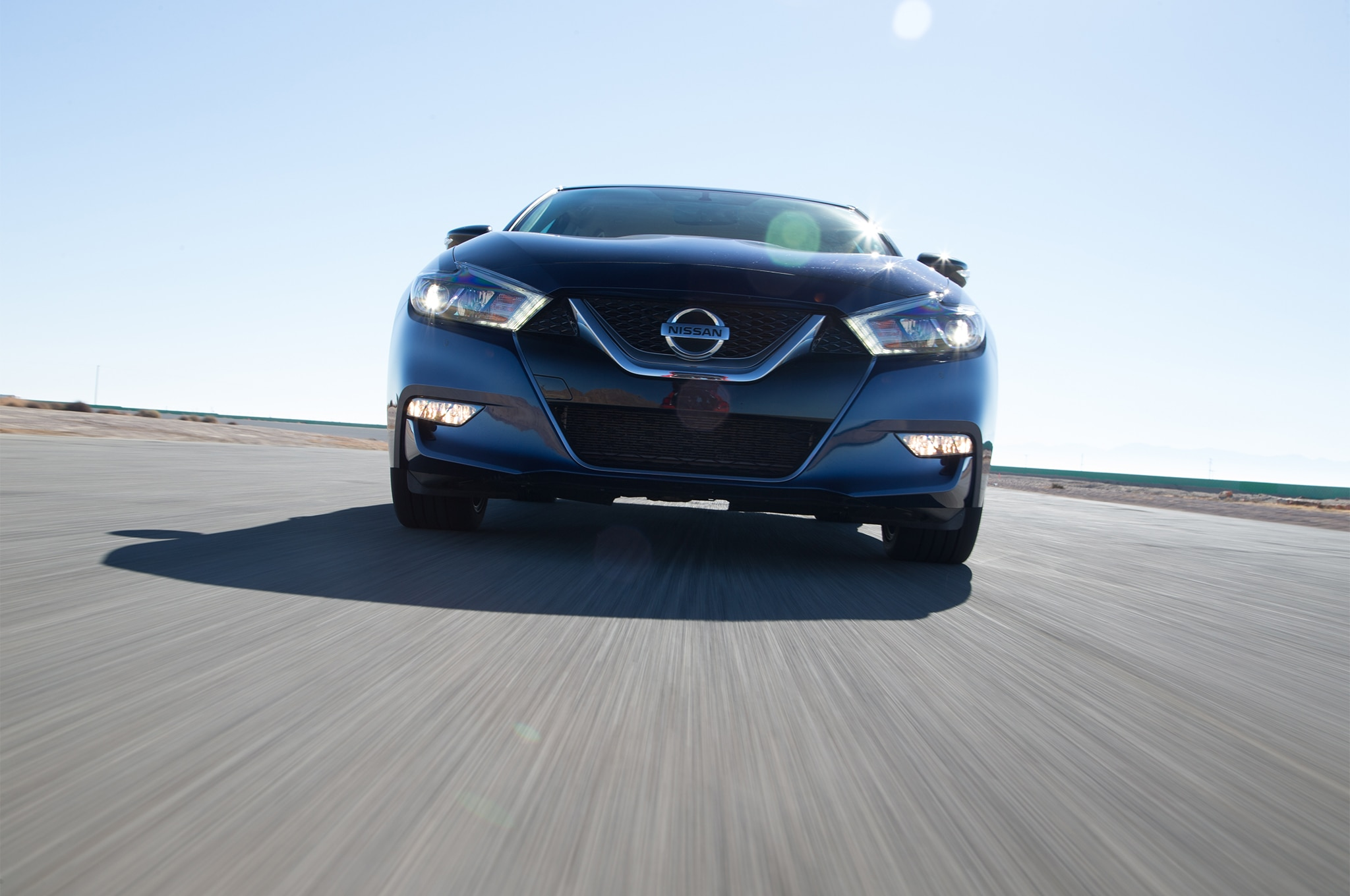 2016 Nissan Maxima SR front view in motion 01 four seasons 2016 nissan maxima sr vs 2016 bmw 340i automobile  at gsmx.co