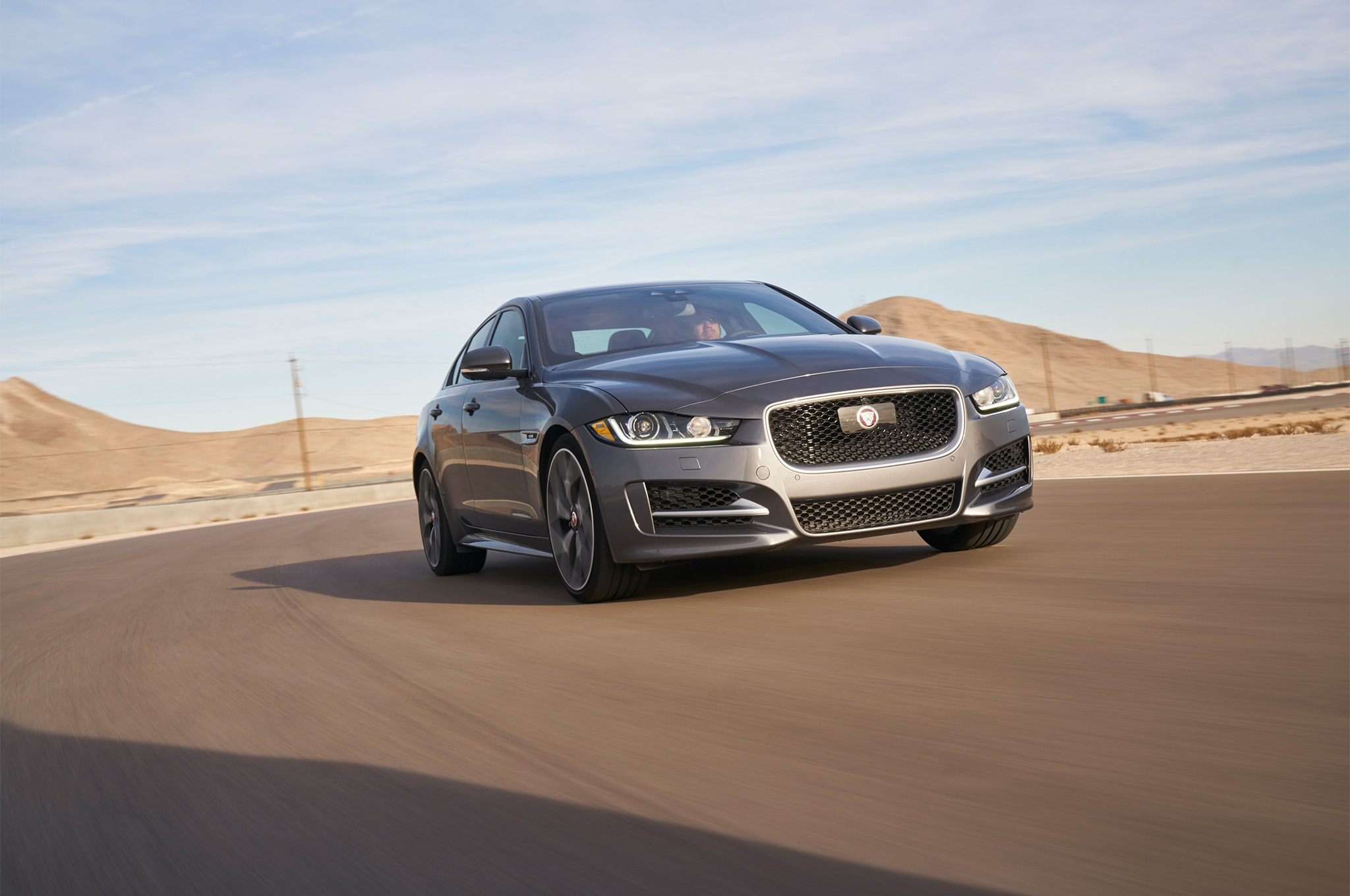 2017 Jaguar XE 35t R Sport Front Three Quarter In Motion 02