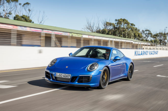 2017 Porsche 911 Carrera 4 GTS Coupe front three quarter in motion 08