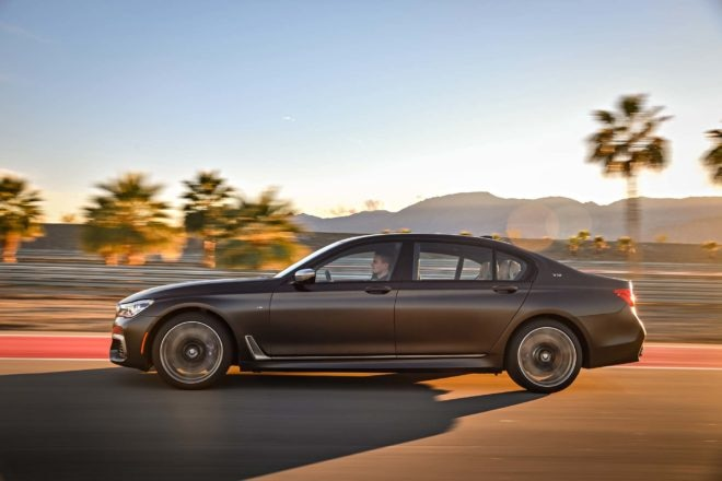 2017 BMW M760i xDrive side in motion 02