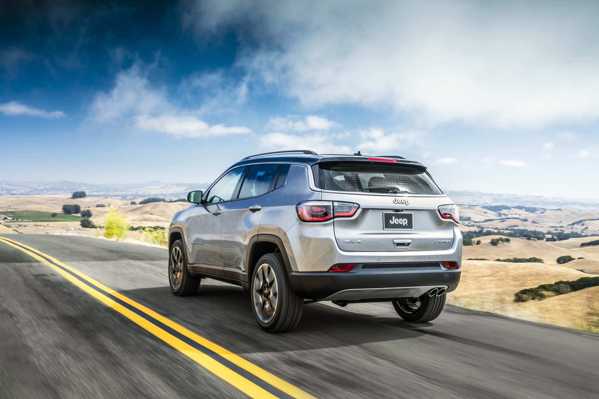 2017 Jeep Compass Limited Rear Three Quarter In Motion 02