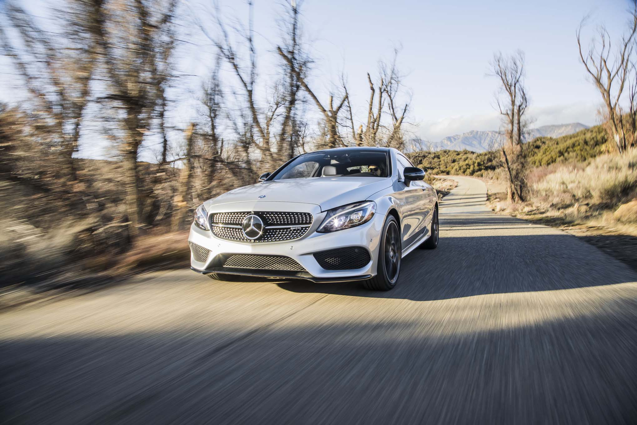 2017 Mercedes AMG C43 Coupe Front Three Quarter In Motion 04