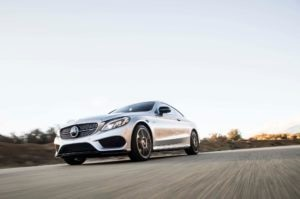 2017 Mercedes AMG C43 Coupe front three quarter in motion 07