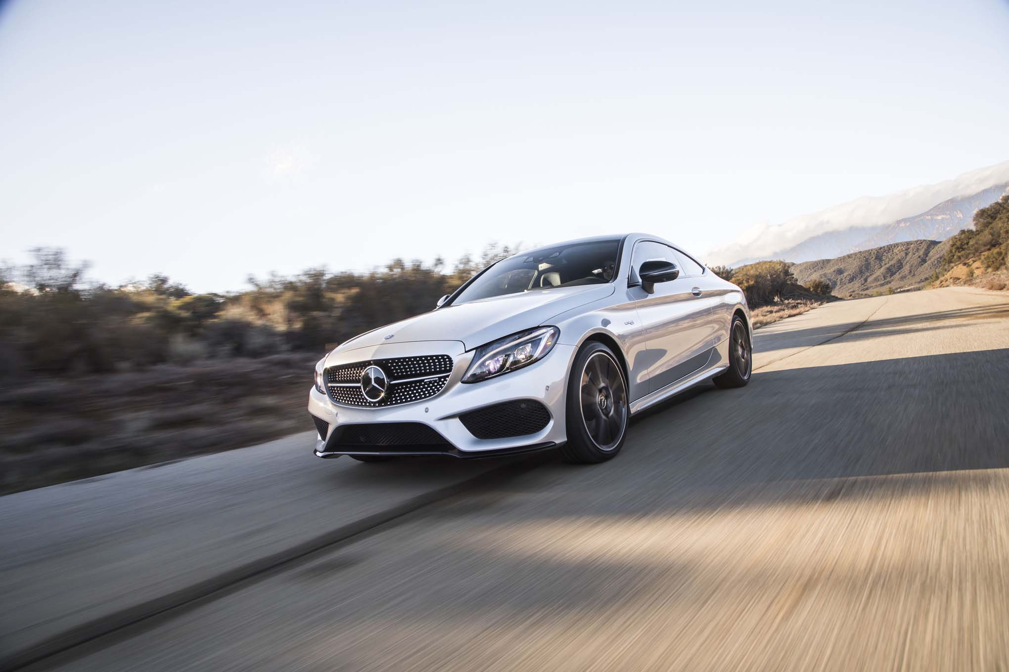 2017 Mercedes AMG C43 Coupe Front Three Quarter In Motion 08