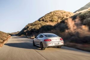 2017 Mercedes AMG C43 Coupe rear three quarter in motion 02