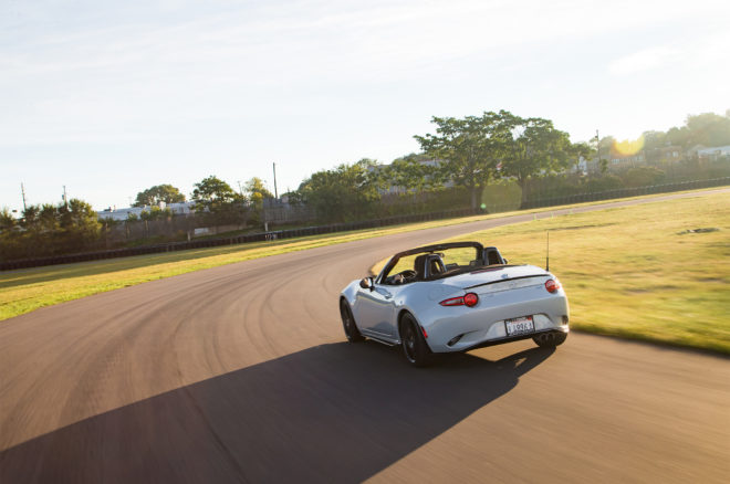 2016 Mazda MX 5 Miata Club rear three quarter in motion 07