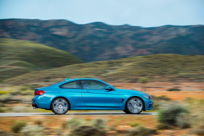 2018 BMW 4 Series Coupe side profile in motion 04