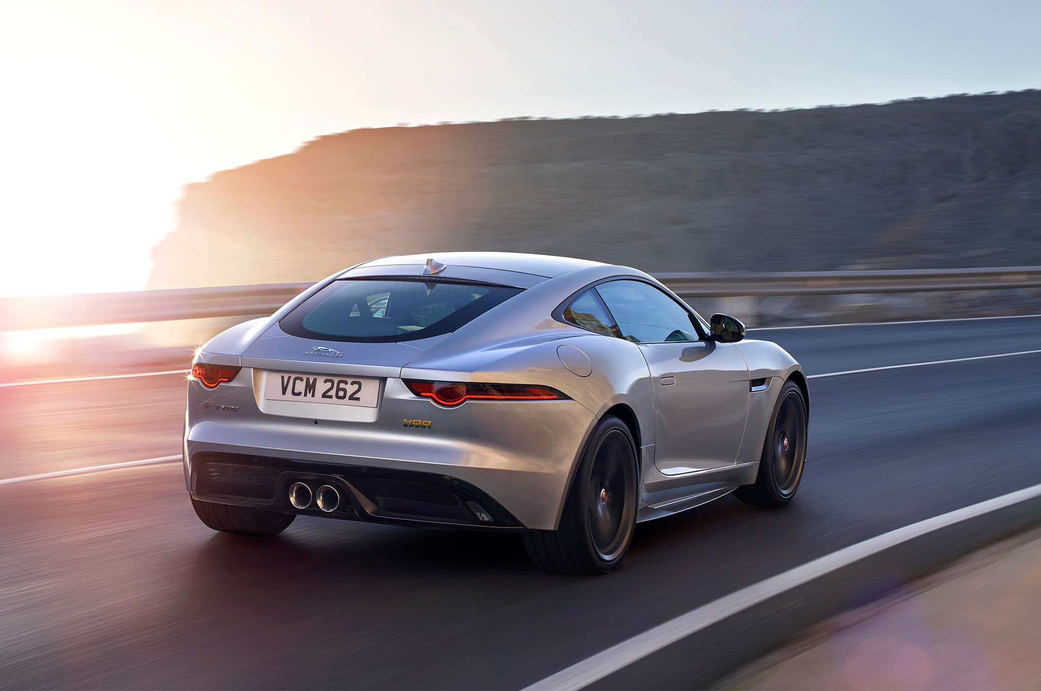 2018-Jaguar-F-Type-400-Sport-rear-three-quarter-in-motion-9