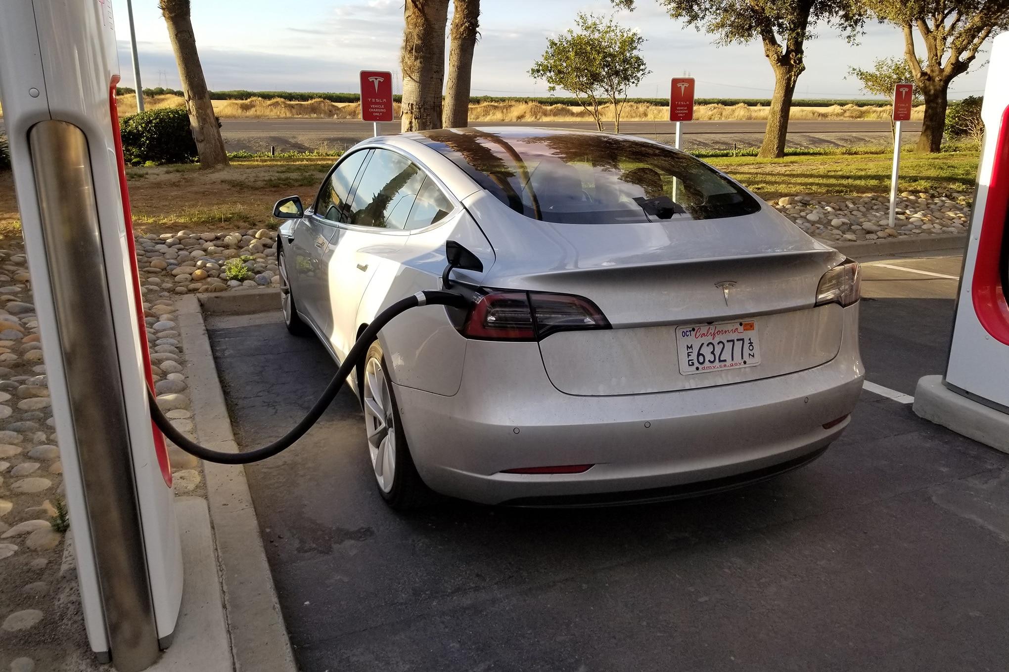 Tesla Model 3 At Supercharger Rear