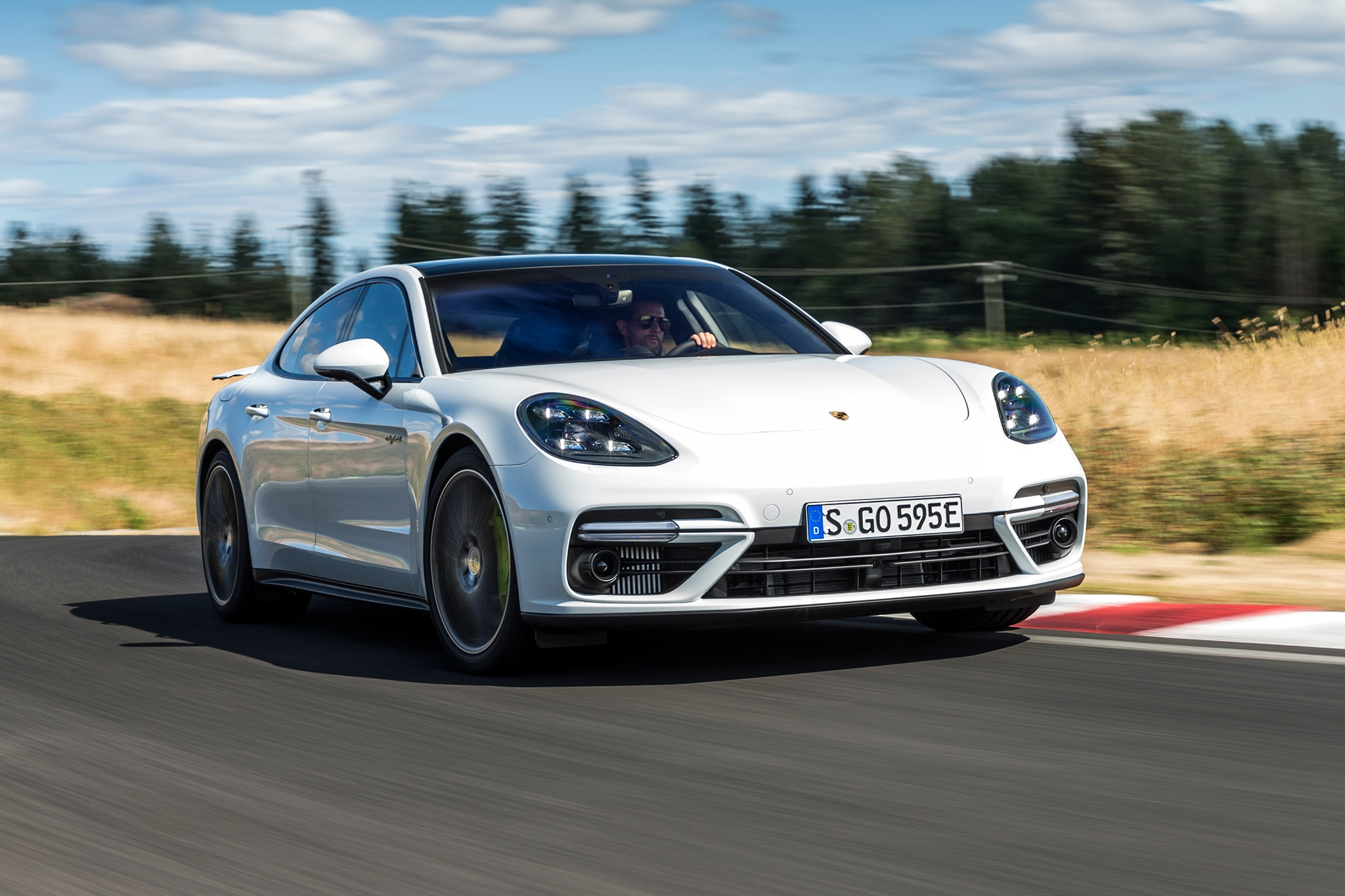 2018 Porsche Panamera Turbo S E Hybrid Front Three Quarter In Motion 12