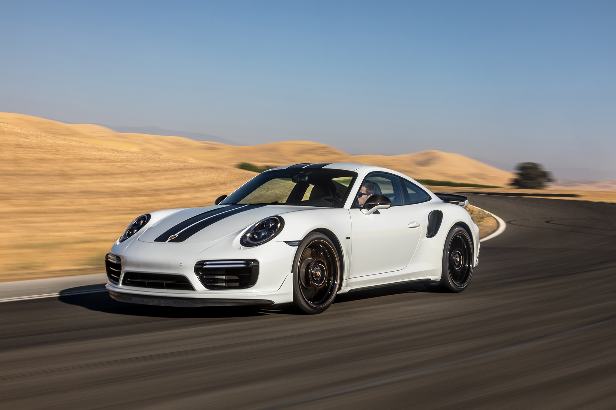 2018 Porsche 911 Turbo S Exclusive Front Three Quarter In Motion 01