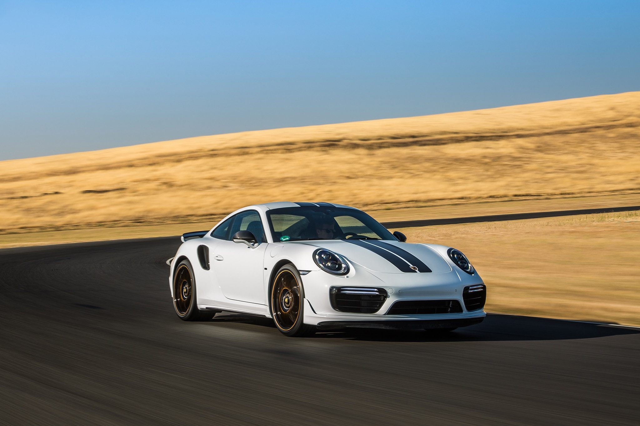2018 Porsche 911 Turbo S Exclusive Front Three Quarter In Motion 03