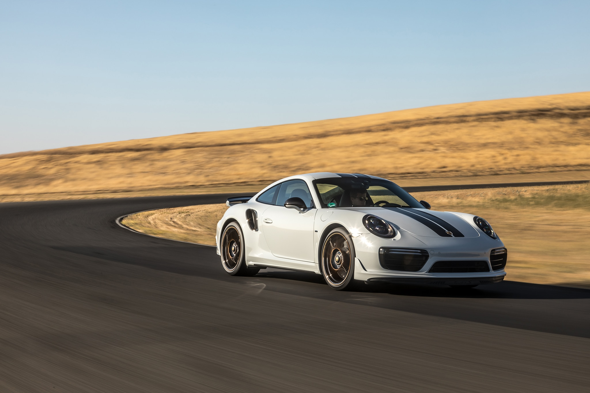 2018 Porsche 911 Turbo S Exclusive Front Three Quarter In Motion 04