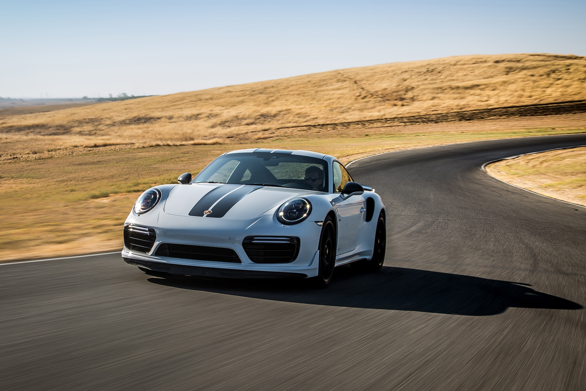 2018 Porsche 911 Turbo S Exclusive Front Three Quarter In Motion 07
