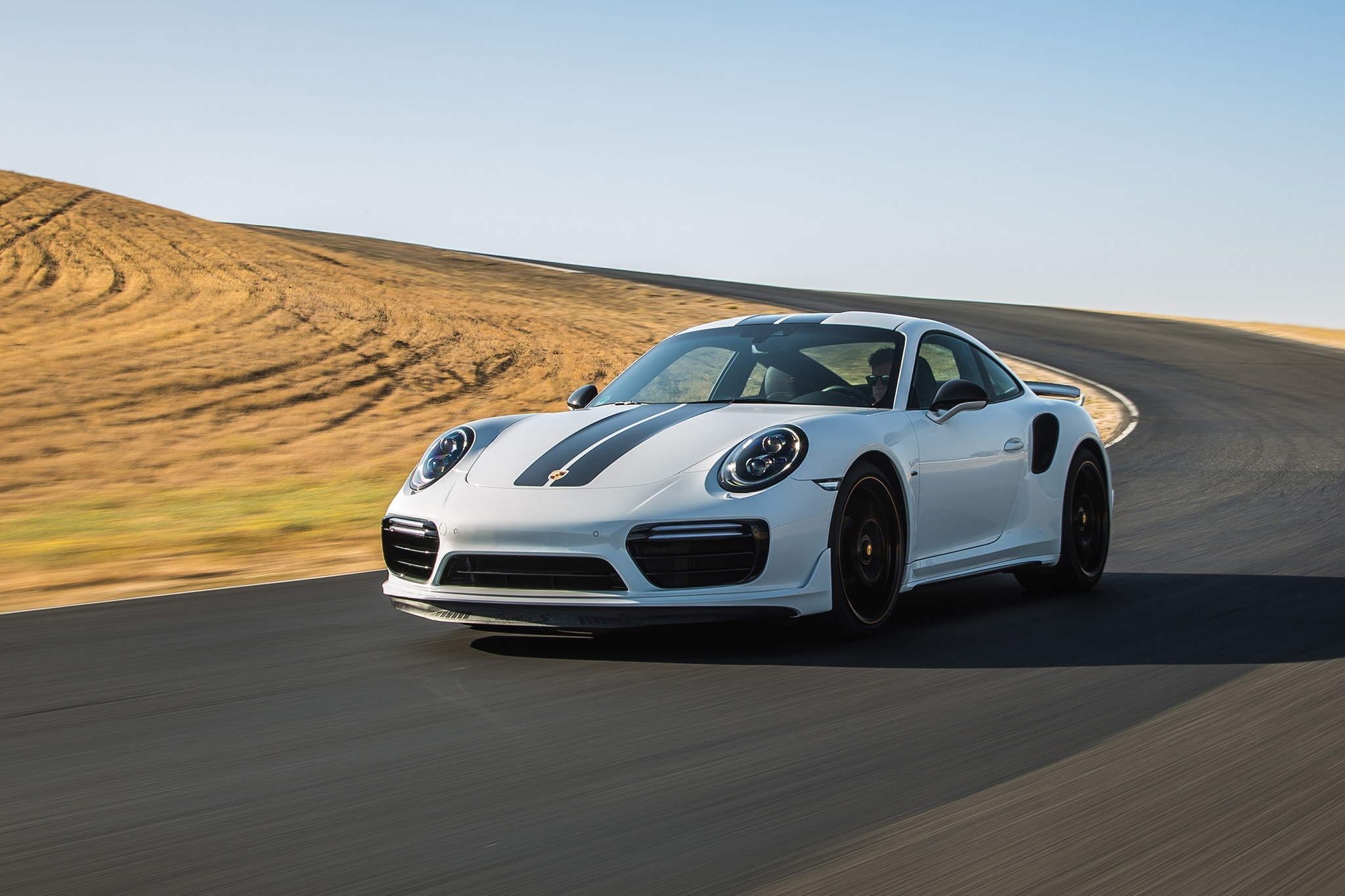 2018 Porsche 911 Turbo S Exclusive Front Three Quarter In Motion 08